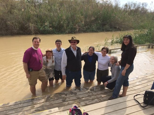 Pilgrims from the diocese of Olympia hanging out in the very cold waters of the Jordan River.