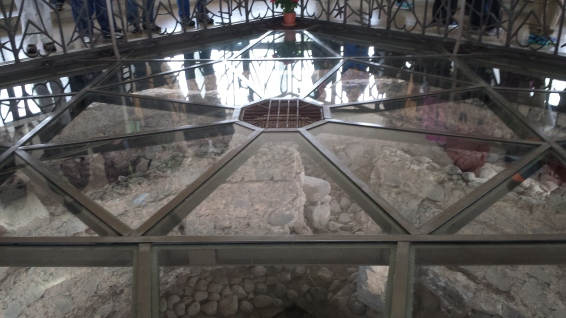 A glass floors provides viewing down into the ruins
