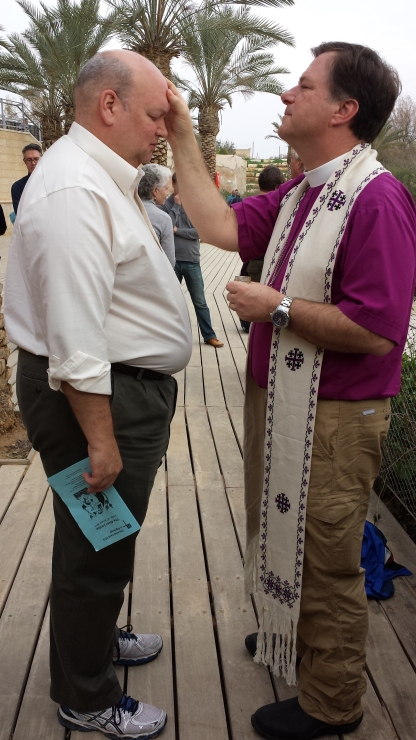Bishop Greg anointing Dean Steve Thomason of St. Mark's Cathedral.