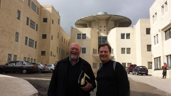Bishops Greg and Barry in front of the college.
