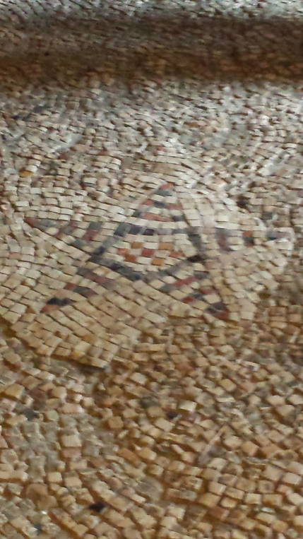 A Byzantine mosaic in the floor of the church - the star seen by the shepherds.