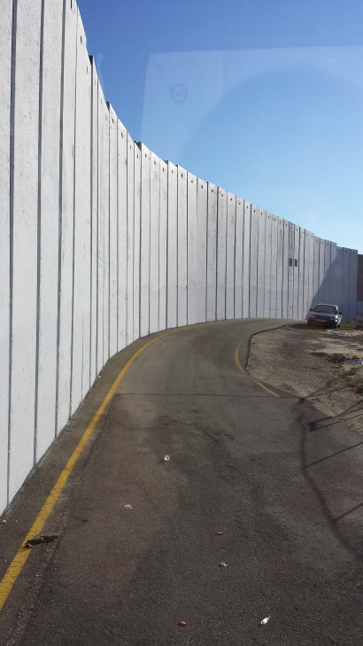 The wall at the check point going out of Bethlehem.