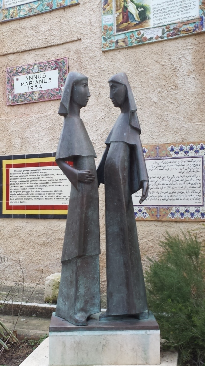 Statue of the Visitation in the court yard. The Magnifcat is displayed in several different languages on tiles around the walls.