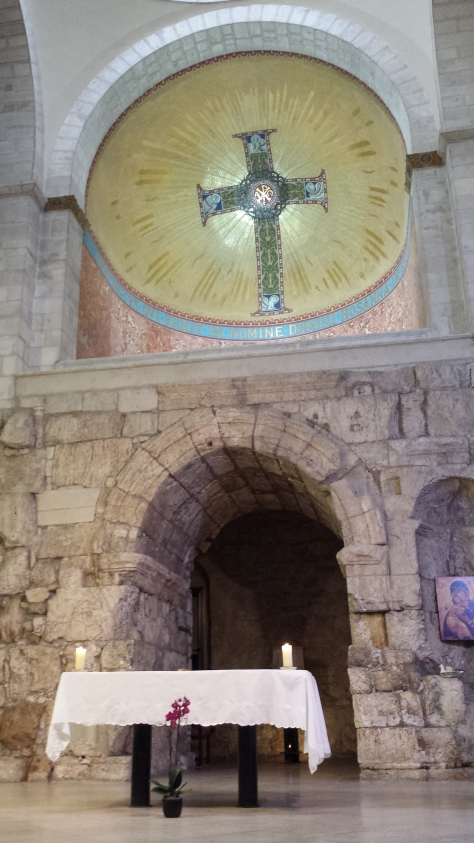 Altar area of Ecce Homo Convent Church - you can see the remnants of one of the arches from the Roman era