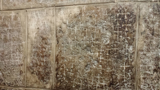Crusader crosses etched into the walls of the oldest portion of the Holy Sepulcher church