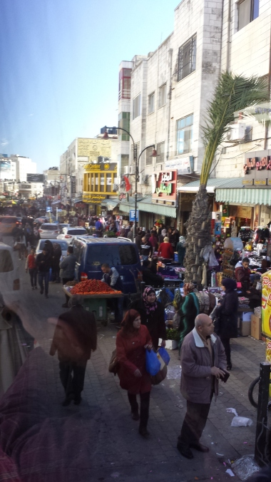 Bus vs. Busy market street in Ramallah